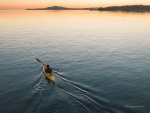 Person in kayak on lake