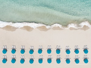 sea, Beach, parasols and sun bathing chairs from directly above