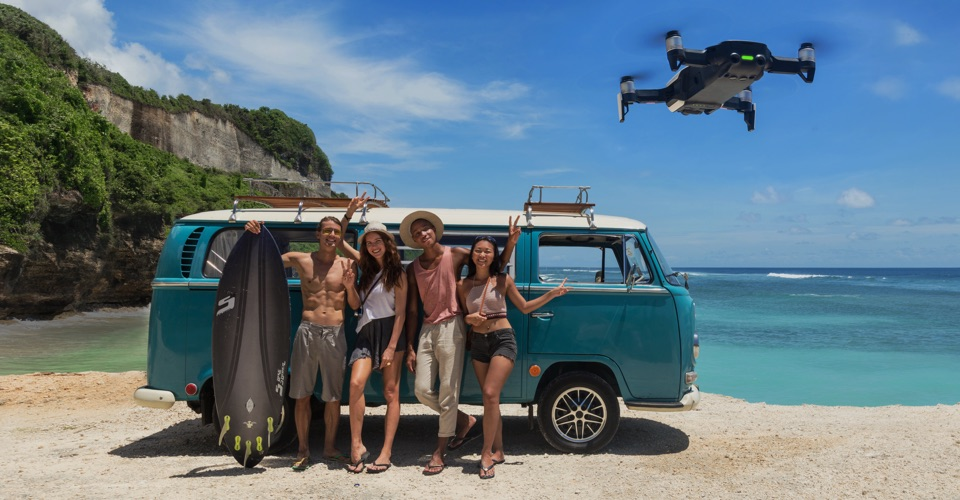 group of people posing infront of the Mavic Air