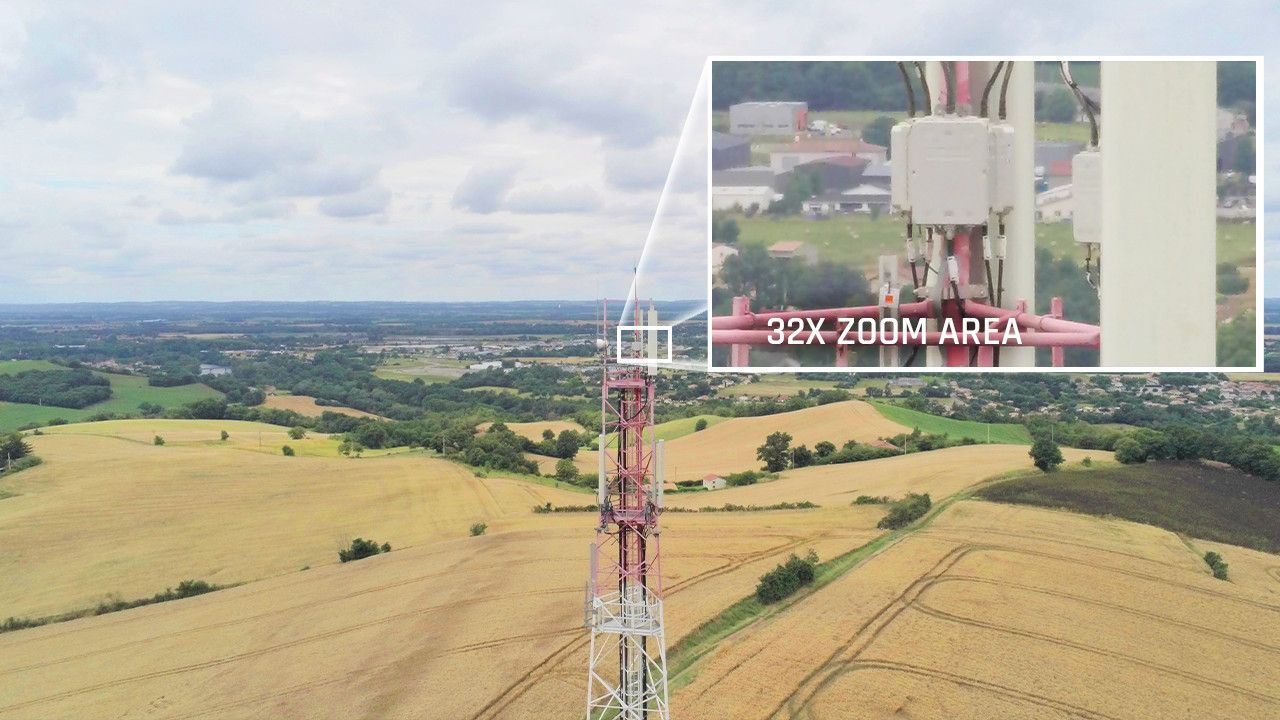 A comparison of the camera's ability with no zoom and 30x zoom inspecting a radio tower